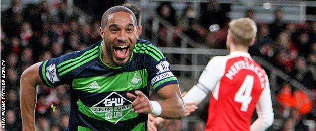 Ashley Williams celebrates scoring for Swansea against Arsenal