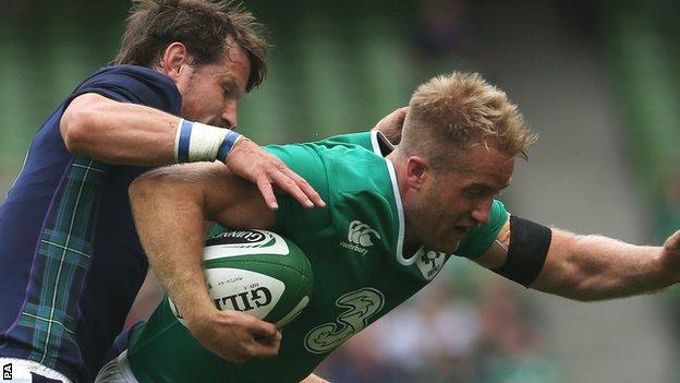 Scotland's Peter Horne tackles Ireland winger Luke Fitzgerald