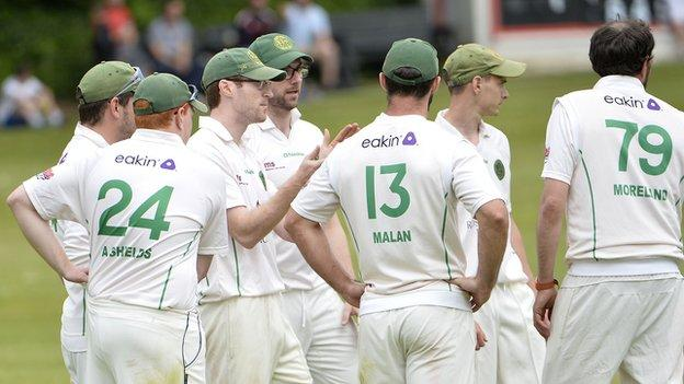 North Down celebrate taking a Derriaghy wicket