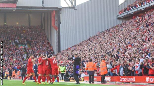 Roberto Firmino and his Liverpool team-mates celebrate the opening goal against Leicester