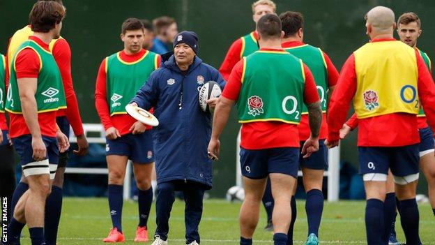 Eddie Jones and several England players in training