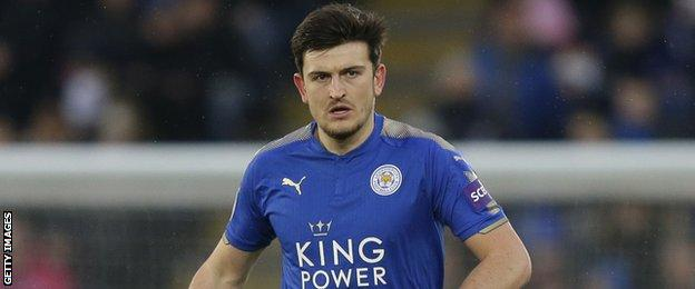 Leicester City defender Harry Maguire looks up as he carries the ball forward against Swansea City in the Premier League