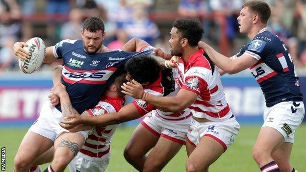 Wakefield Trinity's Jay Pitts is tackled by three Leigh Centurions players