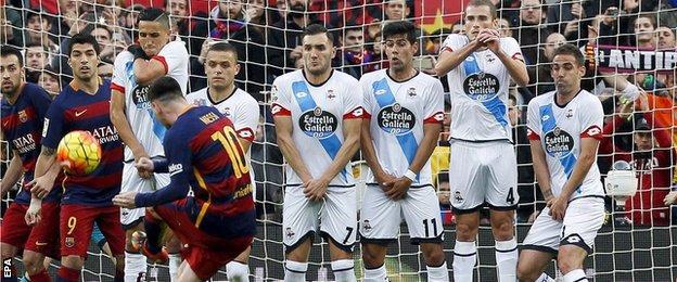 Lionel Messi scores with a free-kick for Barcelona against Deportivo La Coruna