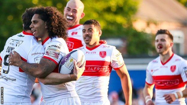 Shaun Lunt celebrates his try with the Rovers teammates.