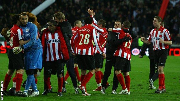PSV players celebrate beating Spurs in 2008