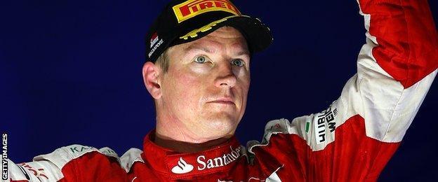 Kimi Raikkonen celebrates after finishing third at the Singapore grand prix