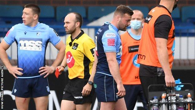 Cardiff Blues centre Owen Lane is shown the red card by Scottish referee Mike Adamson