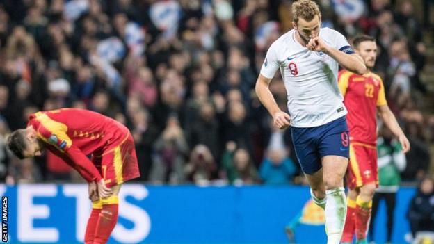 Harry Kane celebrates scoring for England