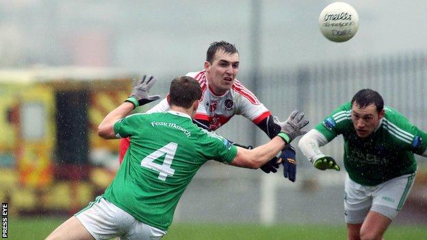 Derry's Ryan Bell is challenged by Fermanagh's Che Cullen with Eoin Donnelly also pictured