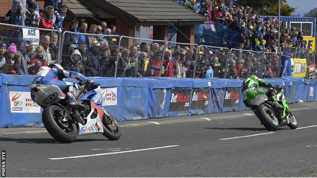 Derek McGee leads the second Supersport race from William Dunlop, who went on to win