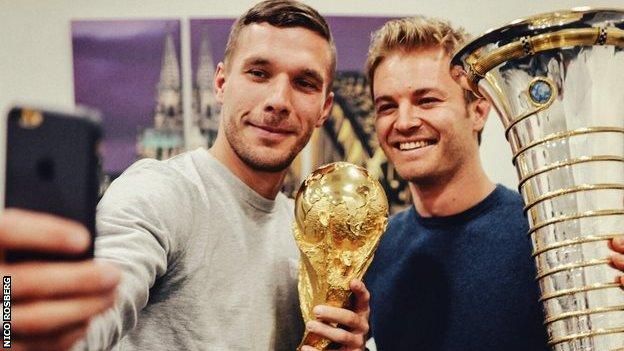 There were trophies aplenty on show when World Champion Nico Rosberg posed with his German compatriot and football World Cup winner Lukas Podolski.