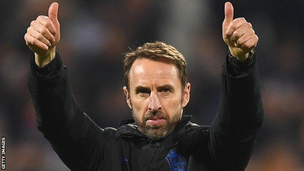 Gareth Southgate puts his thumbs up to England supporters