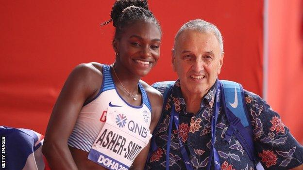 Asher-Smith celebrates victory with her coach John Blackie