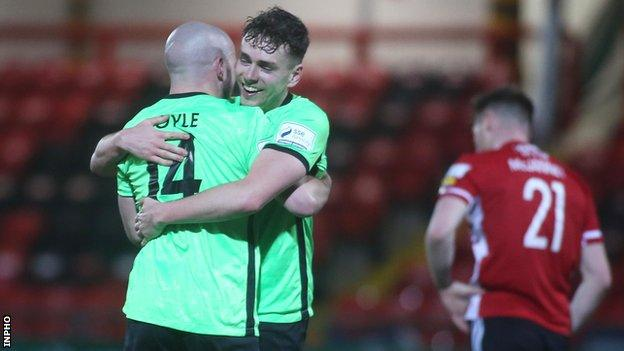 Harps pair Mark Coyle and Mark Russell celebrate beating Derry in the derby