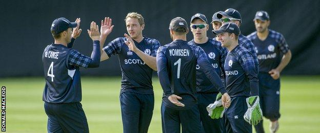 Josh Davey is congratulated after taking one of his three wickets in Edinburgh