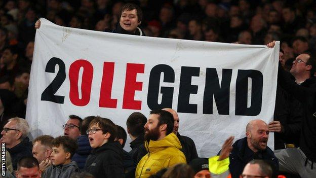 Ole Gunnar Solskjaer banner being held up by Manchester United supporters