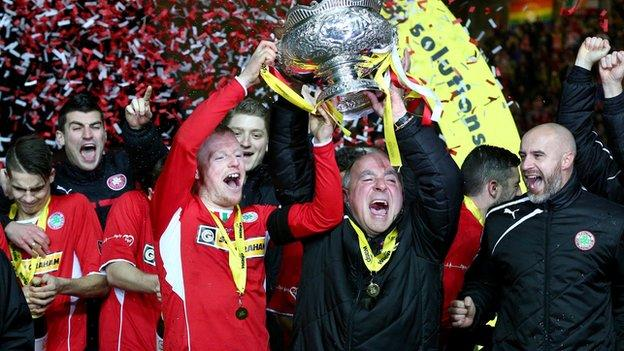 Cliftonville captain George McMullan and manager Tommy Breslin celebrate League Cup success