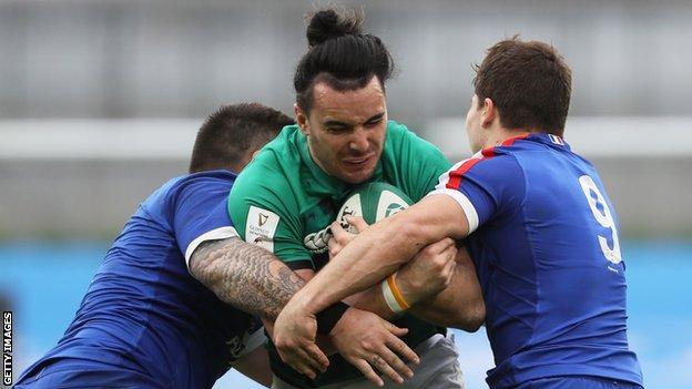Ireland's James Lowe is tackled by France's Cyril Bailie and Antoine Dupont