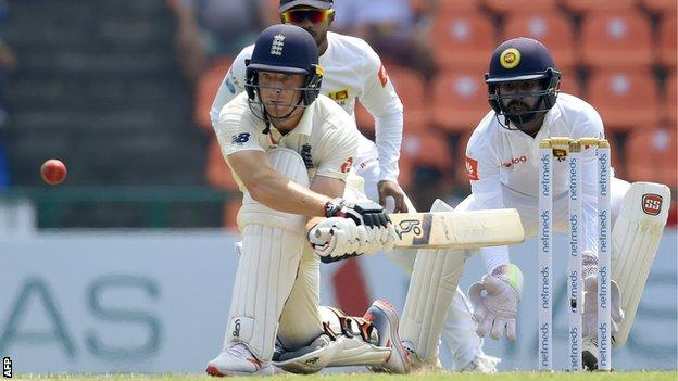 England batsman Jos Buttler plays a reverse sweep shot against Sri Lanka