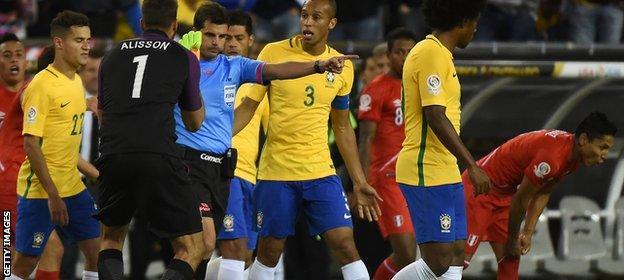 Brazil players complain at Peru winner