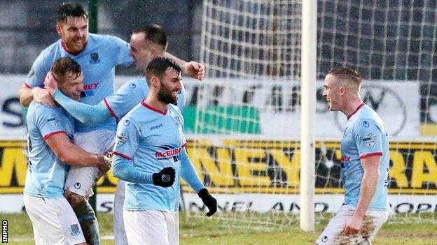 Ballymena players celebrate Leroy Millar's opening goal
