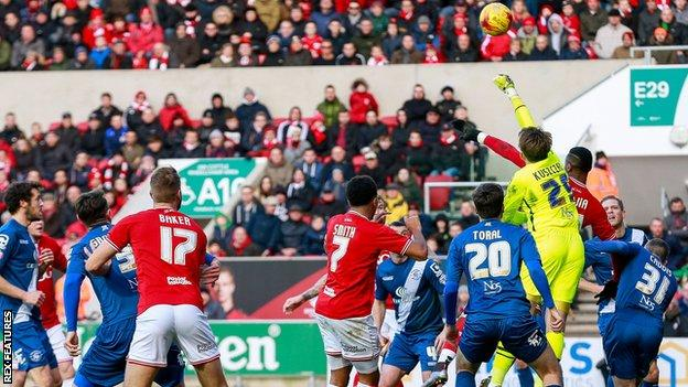 Birmingham keeper Tomasz Kuszczak clears as Bristol City put him under pressure
