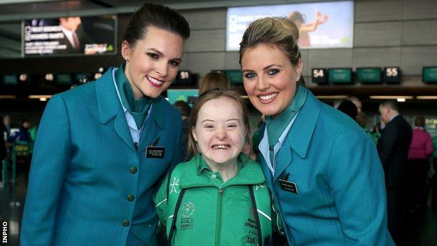 Dearbhail Savage (centre) with Aer Lingus cabin staff Lisa Jane Dorman and Claire Teehan at Dublin Airport last Tuesday
