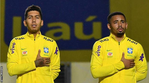 Roberto Firmino of Liverpool and Gabriel Jesus of Manchester City