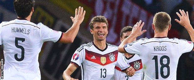 Thomas Muller is congratulated on opening the scoring for Germany at Hampden