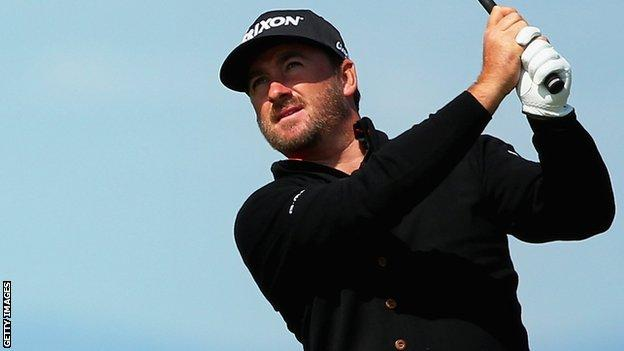 Graeme McDowell plays an approach shot at the 13th at Gullane on Thursday