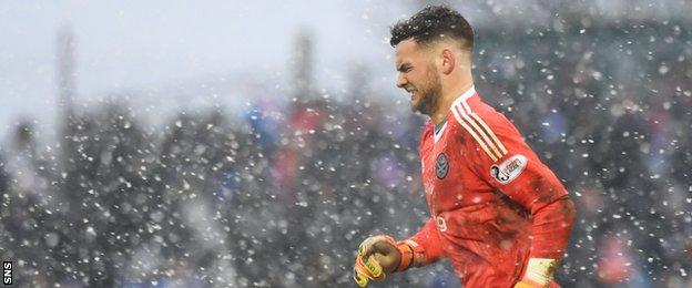 Ayr goalkeeper Jack Ruddy in the snow