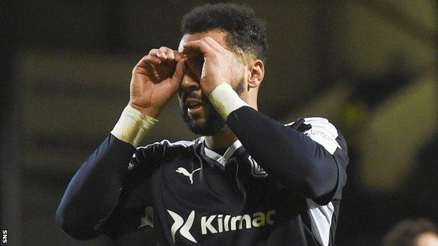 Dundee's Kane Hemmings celebrates