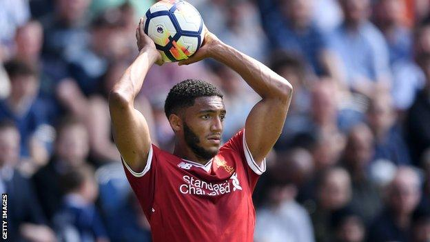 Liverpool's Joe Gomez takes a throw-in