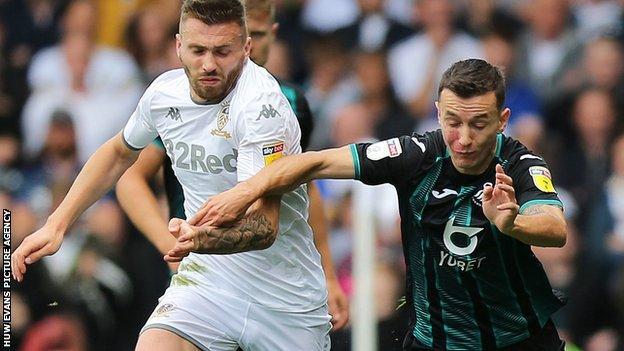 Swansea City's Besant Celina in action against Stuart Dallas of Leeds