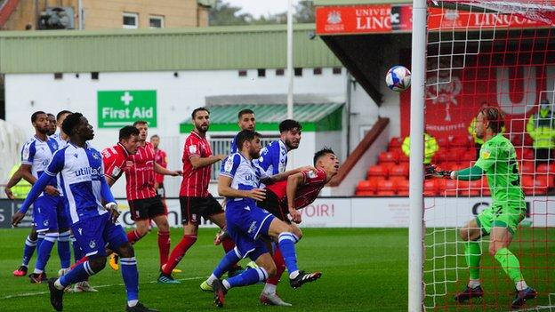 Jorge Grant's free-kick is headed home by Lewis Montsma for Lincoln