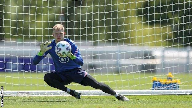 Aaron Ramsdale saves a shot in England training
