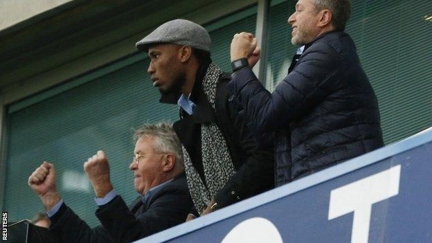 Guus Hiddink (left), Didier Drogba (centre) and Roman Abramovich