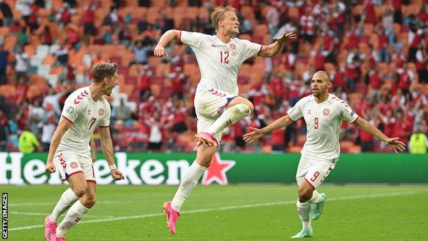 Kasper Dolberg (centre) leads Denmark's celebrations after his second goal of the game