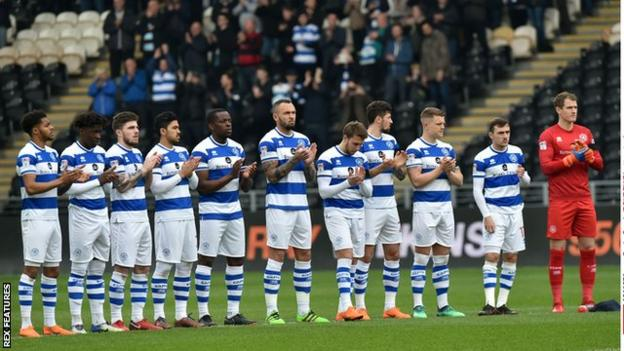 Players of Queens Park Rangers, where Wilkins was a player and a manager, paid tribute before the Championship match at Hull City