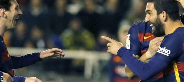 Turan celebrates his first Barcelona goal