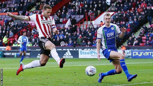 Sheffield United captain Billy Sharp scores his second goal for Sheffield United against Wigan Athletic