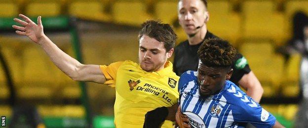 Livingston's Alan Forrest battles with Kilmarnock's Aaron Tshibola