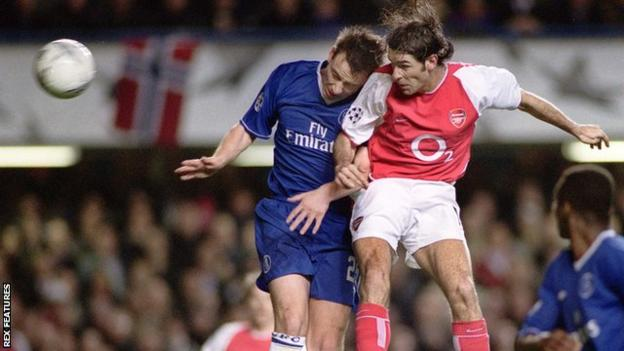 Robert Pires beats John Terry in the air to score for Arsenal against Chelsea in 2004
