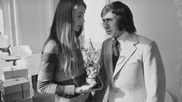 Scottish racing driver Jackie Stewart pictured with Nina Rindt, widow of Austrian racing driver Jochen Rindt, in London on 18th November 1970