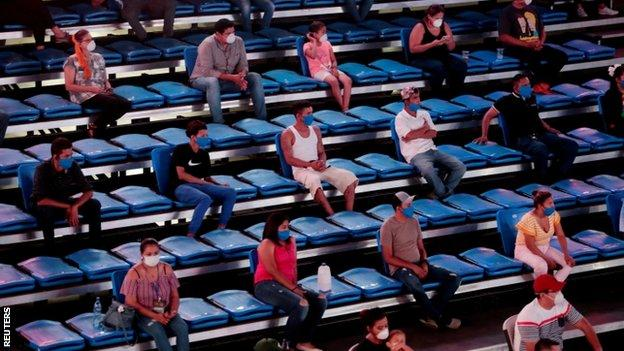 Spectators were told to sit two seats apart