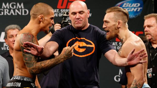 Dustin Poirier and Conor McGregor squaring up in 2014