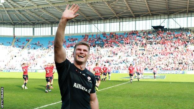 Owen Farrell smiles and waves at the crowd