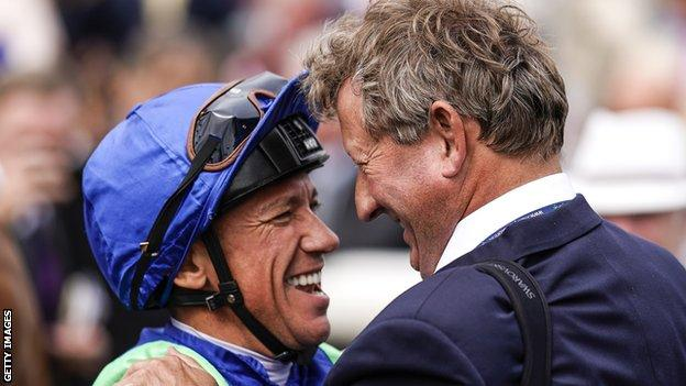 Johnston celebrated with Dettori after Poet Society's victory
