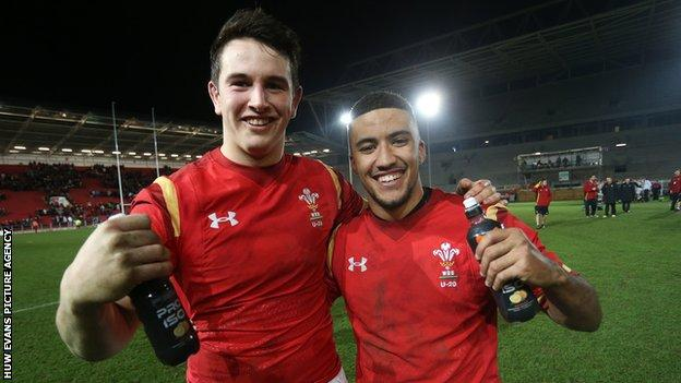 Owen Watkin and Keelan Giles of Wales Under-20 celebrate after beating England on the way to the junior Grand Slam